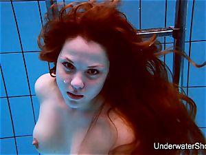 jaw-dropping damsel showcases wonderful figure underwater