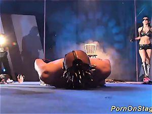 extreme fetish display on stage