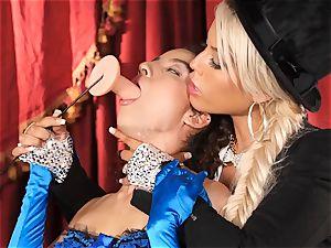 Bridgette B puts torrid assistant Lana Lovelace thru her paces