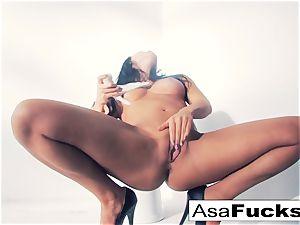 Asa Akira uses a fake arm to please her poon